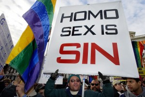 People for and against same-sex marriage demonstrate outside the Massachusetts Statehouse in Boston